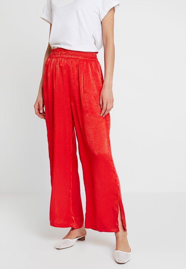 SIANA LONG FLARED PANTS - Pantalones - patrol red