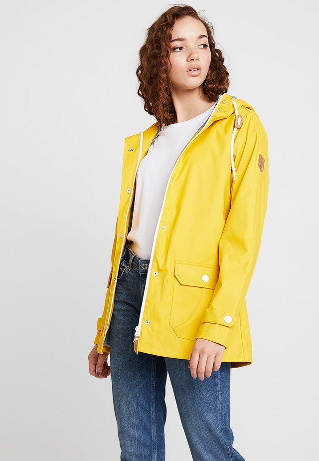 PENINSULA FISCHER - Regnjacka - yellow