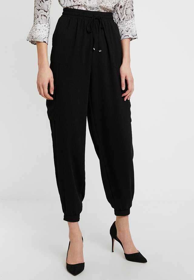 UTILITY CUFFED  - Pantalon de survêtement - black
