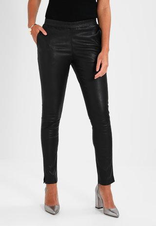 GALAPAGOS - Leather trousers - black
