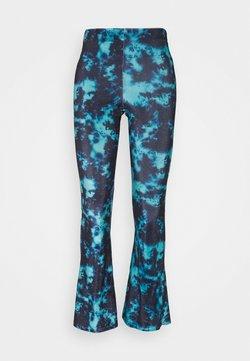 Topshop Petite - TIE DYE FLARE - Trousers - blue