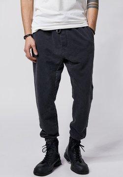Tigha - ELIOT - Jogginghose - vintage black