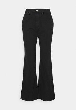 Third Form - SPLIT SIDE JEAN - Jeans a zampa - washed black