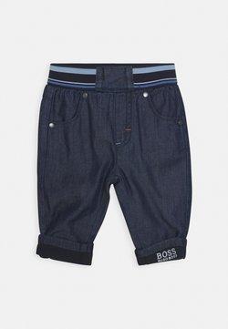 BOSS Kidswear - TROUSERS BABY - Jeans Tapered Fit - blue denim
