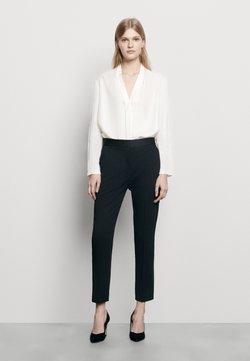 sandro - QUANG - Spodnie materiałowe - noir