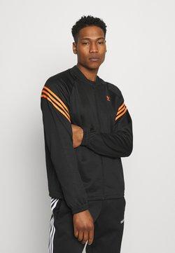 adidas Originals - SWAROVSKI TRACK UNISEX - Trainingsjacke - black/trace orange