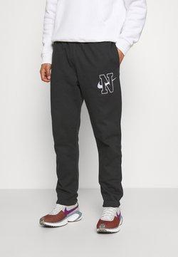 Nike Sportswear - RETRO PANT - Jogginghose - off noir