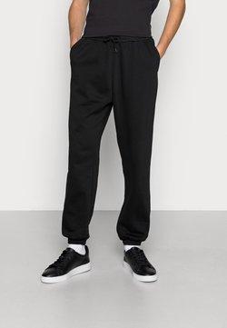 Weekday - SEBBE NARROW PANTS - Verryttelyhousut - black