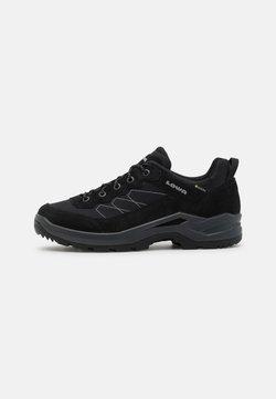 Lowa - TAURUS PRO GTX LO - Hiking shoes - schwarz