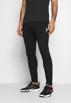 Jack & Jones - JJWILL JJZSWEAT PANTS - Verryttelyhousut - black