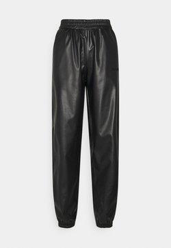 H2O Fagerholt - TRACK SUIT PANT - Trousers - black