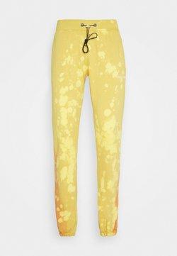 Night Addict - UNISEX - Jogginghose - yellow