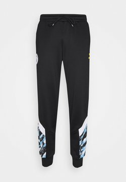 Puma - MANCHESTER CITY ICONIC GRAPHIC TRACK PANTS - Jogginghose - black/spectra yellow