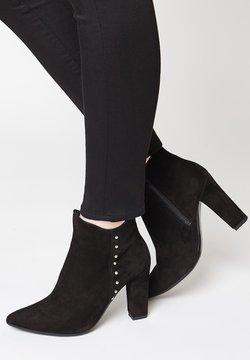 faina - Korte laarzen - schwarz