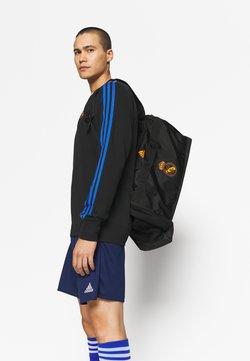 adidas Performance - REAL MADRID M - Vereinsmannschaften - black/lucky orange