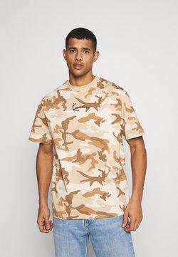 Karl Kani - SMALL SIGNATURE CAMO TEE - T-Shirt print - beige/sand