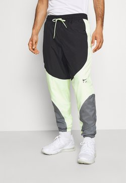 Nike Performance - FLY PANT - Jogginghose - smoke grey/black/barely volt