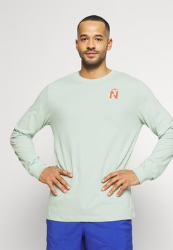 Nike Performance - DRY TEE TRAIL - Funktionsshirt - pistachio frost
