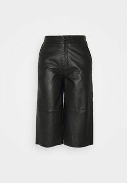 Object Petite - OBJVIOLA L CULOTTE - Leather trousers - black