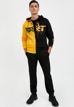 Finn Flare - Jogginghose - black