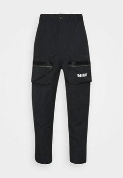 Nike Sportswear - CITY MADE PANT - Reisitaskuhousut - black/white