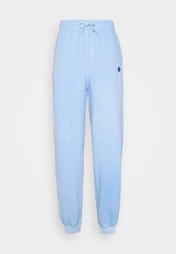Vintage Supply - CORE OVERDYED JOGGER WITH YIN YANG UNISEX - Jogginghose - overdyed sky blue