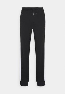 Fila - LARS PANTS - Jogginghose - black/bright white