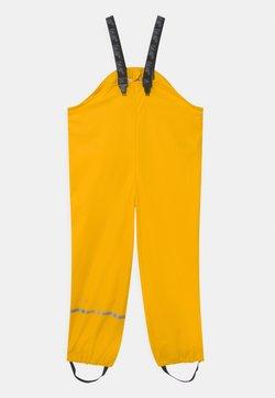 CeLaVi - OVERALL SOLID UNISEX - Pantalon de pluie - yellow