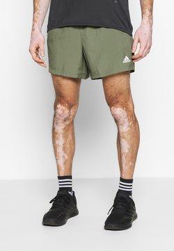 adidas Performance - OWN THE RUN RESPONSE RUNNING  - Pantalón corto de deporte - green