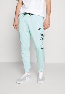Nike Sportswear - Jogginghose - light dew/black