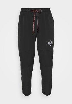 Nike Performance - 7/8 PANT - Jogginghose - black