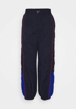 Levi's® - PEANUTS SIMONE TRACK PANT - Jogginghose - dark blue