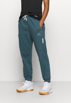 Nike Performance - STANDARD ISSUE PANT - Jogginghose - ash green/pale ivory