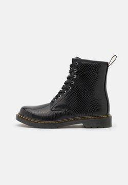 Dr. Martens - 1460 - Lace-up ankle boots - black