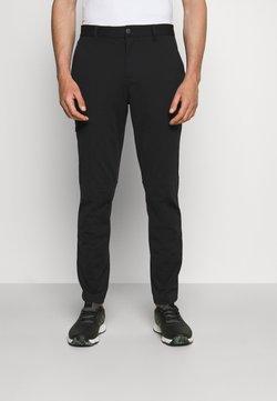 adidas Golf - CARGO PANT - Tygbyxor - black