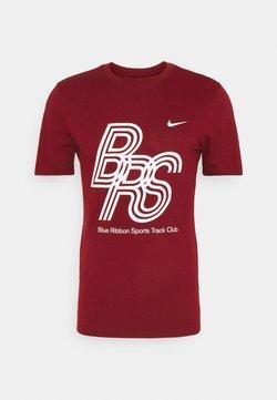 Nike Performance - DRY TEE BRS - Camiseta estampada - team red