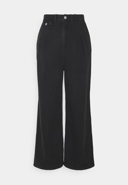Monki - NANI TROUSERS - Flared Jeans - black dark asia