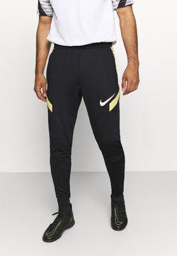 Nike Performance - STRIKE PANT  - Jogginghose - black/saturn gold/white
