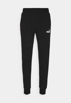 Puma - AMPLIFIED PANTS - Jogginghose - black