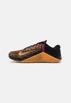 Nike Performance - METCON 6 - Sports shoes - black/metallic gold/chutney