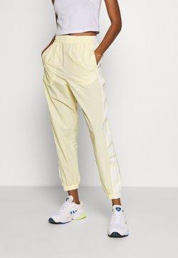 adidas Originals - LOCK UP ADICOLOR NYLON TRACK PANTS - Jogginghose - easy yellow/white