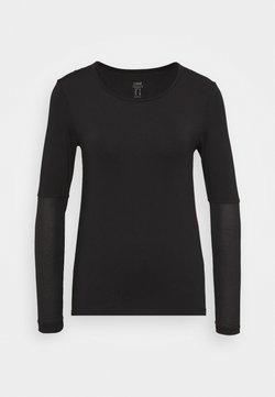 Casall - ICONIC LONG SLEEVE - Pitkähihainen paita - black