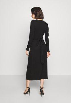 Good American - SOLID WRAP DRESS - Vestido informal - black