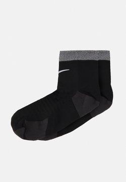 Nike Performance - SPARK CUSH ANKLE UNISEX - Skarpety sportowe - black/reflective