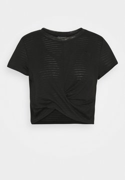Puma - STUDIO TWIST BURNOUT TEE - T-Shirt print - black