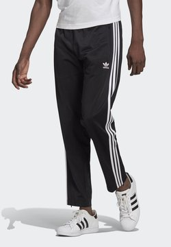 adidas Originals - FIREBIRD UNISEX - Jogginghose - black