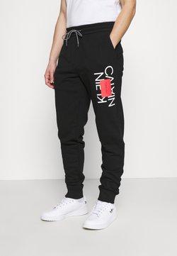 Calvin Klein - TEXT REVERSED  - Jogginghose - black