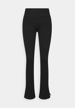 Casall - SEAMLESS SLIT PANTS - Jogginghose - black