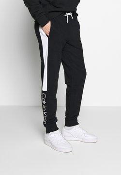 Calvin Klein - OGO STRIPE  - Jogginghose - black