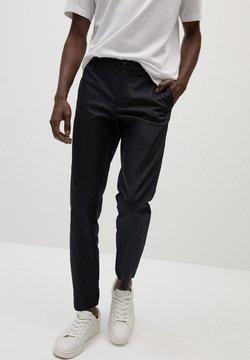 Mango - IN CROPPED LÄNGE - Spodnie materiałowe - schwarz